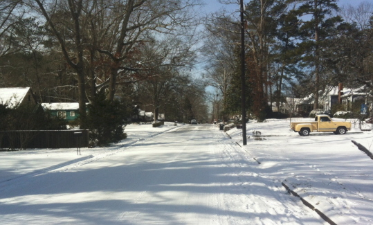 Oakwood Street in the snow. This picture tends to take us back in time.