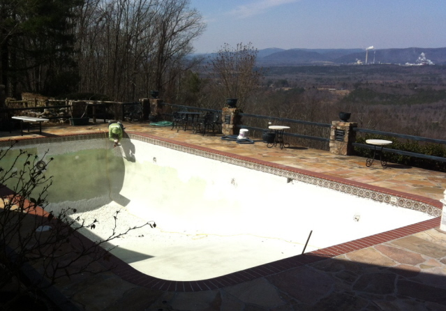 Preparing pool for re-surfacing. Lovely view of the mountain
