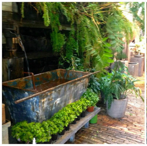 A beautiful aged copper trough for a water feature