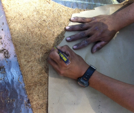 a carpenter's pencil or magic marker will mark the mat for cutting