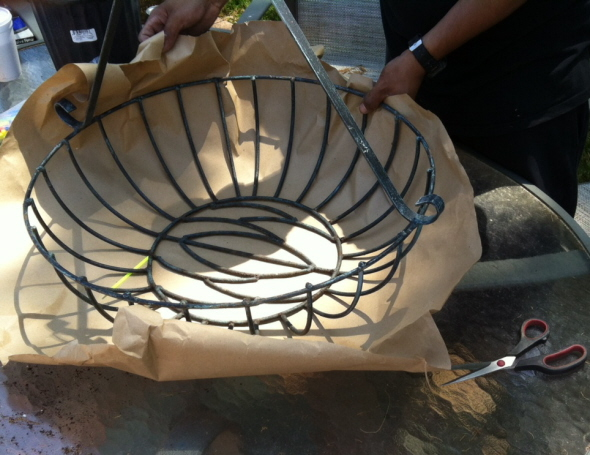 Wrap paper around the wire basket and trim to make a pattern