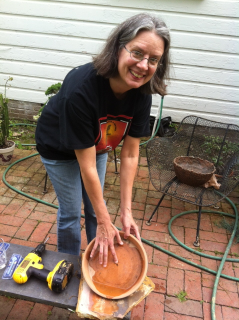 Drill a hole in a clay saucer and use it for a dish garden
