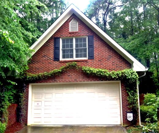 Swagged Carolina jasmine frames a garage door. Here's how to do it