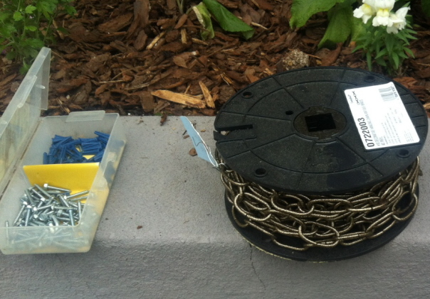 Just what you need--a roll of decorative chain and a wall anchor kit.