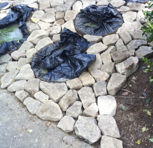 Rocks laid around custom made stepping stones