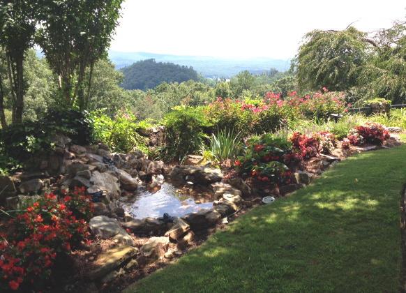 The view of a small fountain extends to the distant mountains