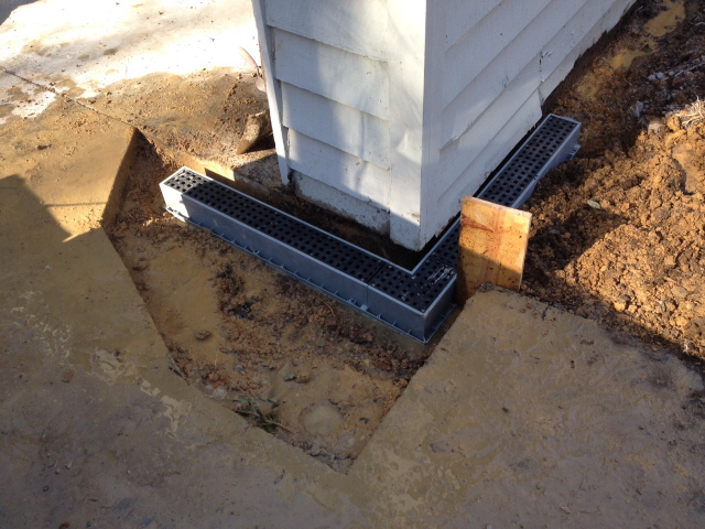 When fitting drainage boxes to be poured in concrete, use the level over and over just to be sure.