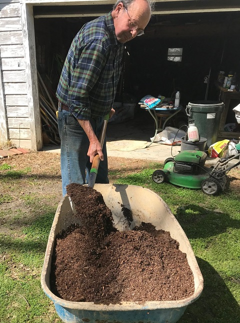 mix potting soil with a shovel